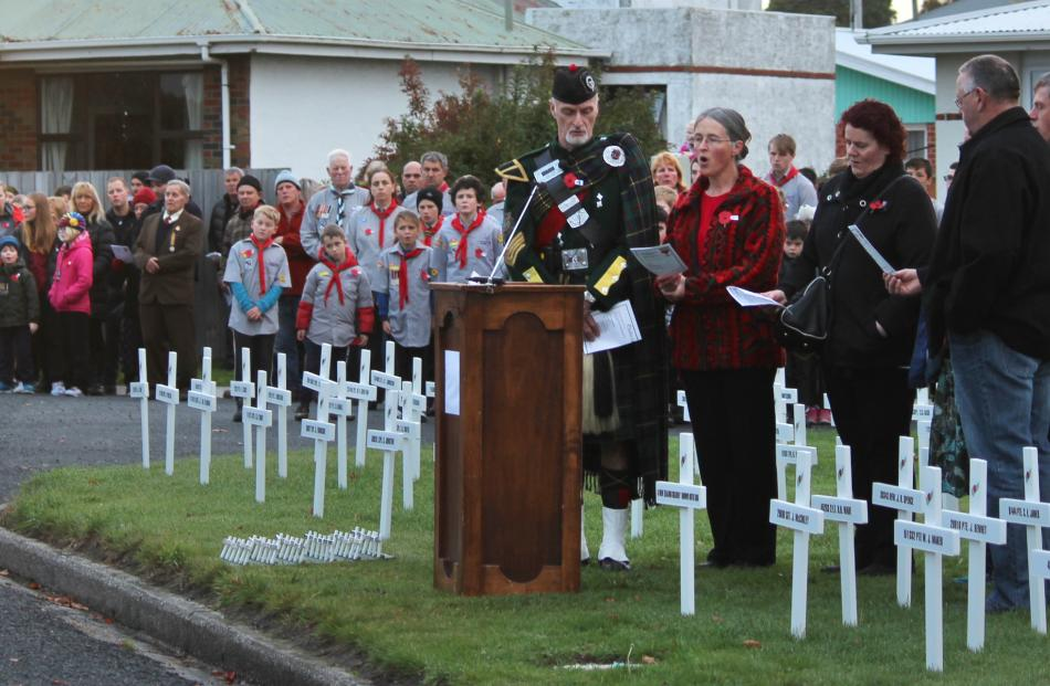 The wreath-laying ceremony at the Balclutha dawn service. Photo by Samuel White.