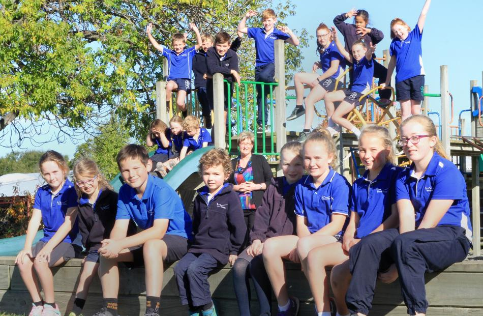 Pupils at the 228-pupil Weston School join principal Nicky Ryan on the playground.  Mrs Ryan says...