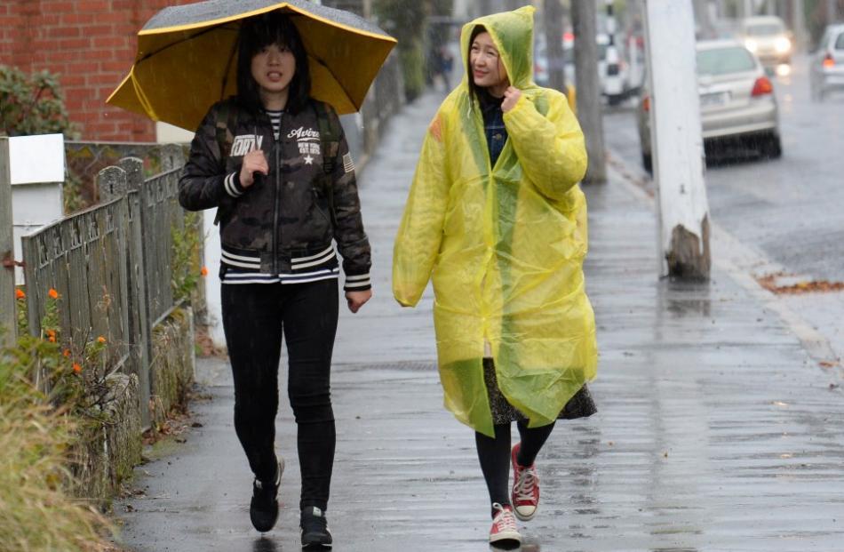 Visitors from China Jun Lin (left) and Cissy Yu make their way along North Rd towards Baldwin St...