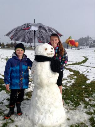 Olivia and Liam McLachlan created a snowman in Cromwell. Encouraging toots from passing traffic...