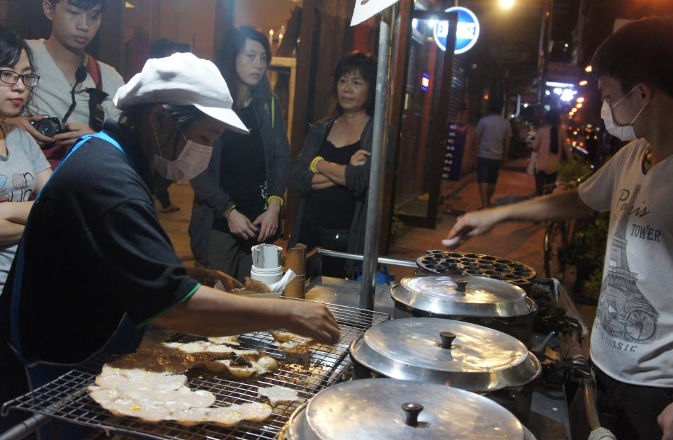 Locals and tourists alike flock to the pop-up restaurant carts that line Chiang Mai's streets and...