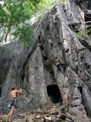 A climber ascends vertically on a tough route at Crazy Horse Crag, a recreational climbing  area...