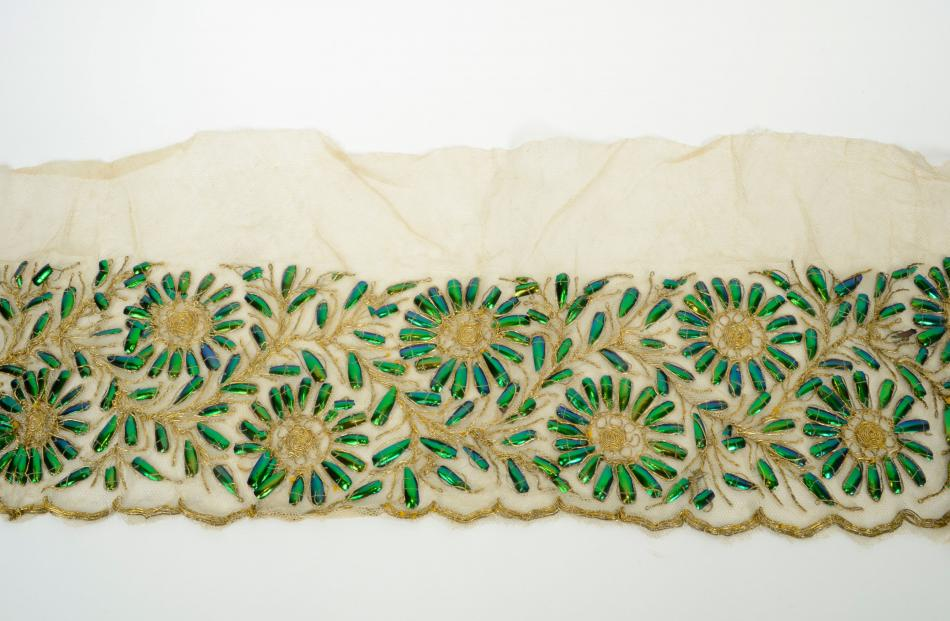 Length of netting embroidered with gold thread and beetle wing covers.