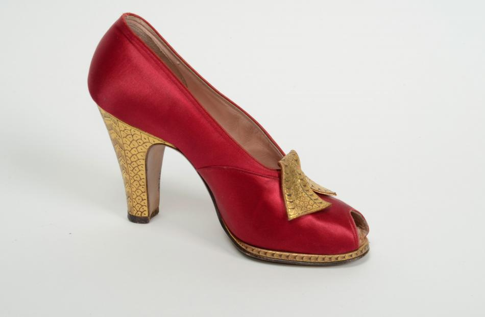 Red satin and gold leather shoe by Frank Brothers, Chicago & New York. Gift of the estate of Mrs Joanne Macaulay.