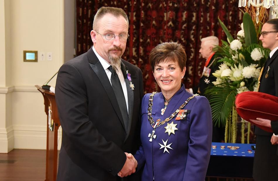 Chris Foot accepts congratulations on his New Zealand Bravery Decoration from Governor-General Dame Patsy Reddy in Wellington yesterday. Photos: Government House.