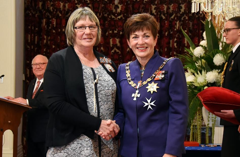 Receiving congratulations from Dame Patsy is Janet Affleck, of Gore - QSM, for services as an...