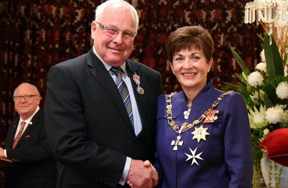 Receiving congratulations from Dame Patsy is John Webster, of Oamaru - QSM, for services to...