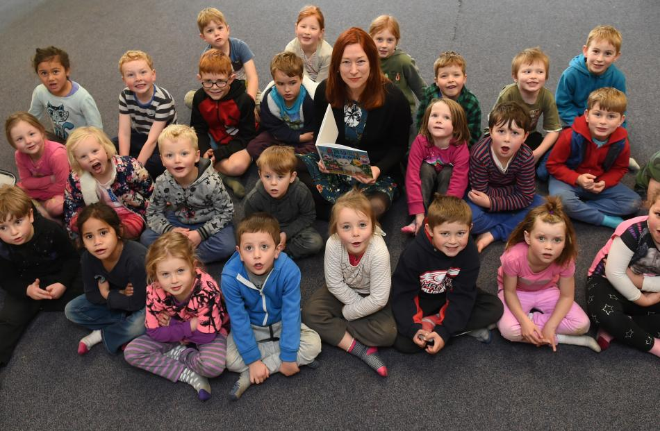 Year 1-3 Port Chalmers School pupils surround author illustrator Kathryn van Beek during her visit to the school yesterday to read her book about Bruce the cat and his life in Port Chalmers. Photos: Gregor Richardson.