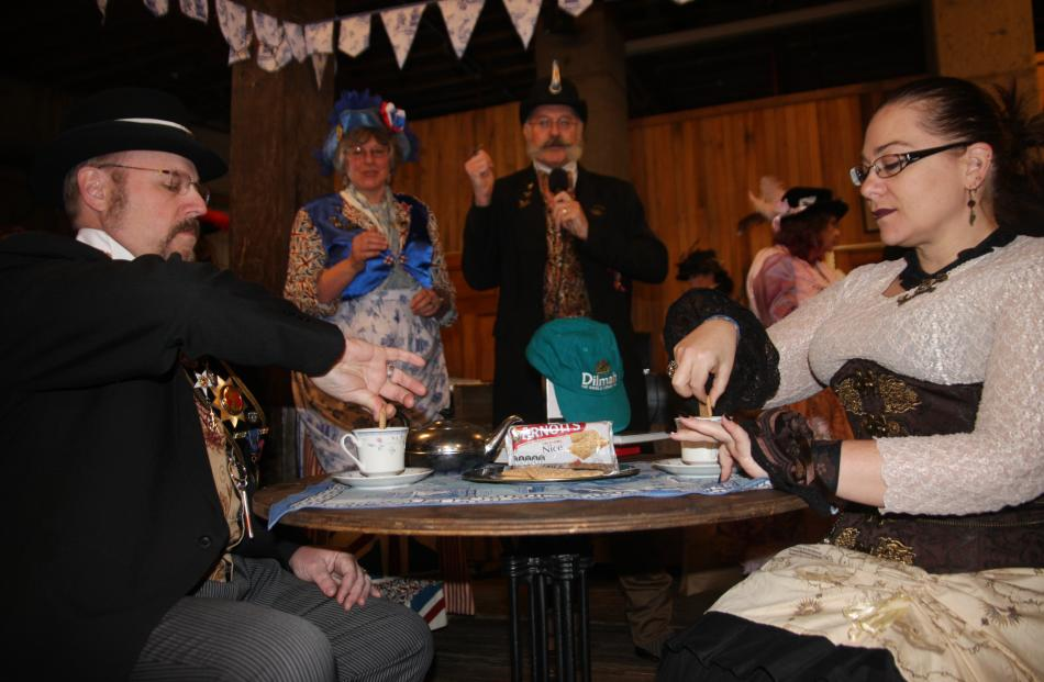 Bob Archer, aka Viscount Eastman Wesley Archardt III, loses a tea duel to Katey Reynish, aka Lady...