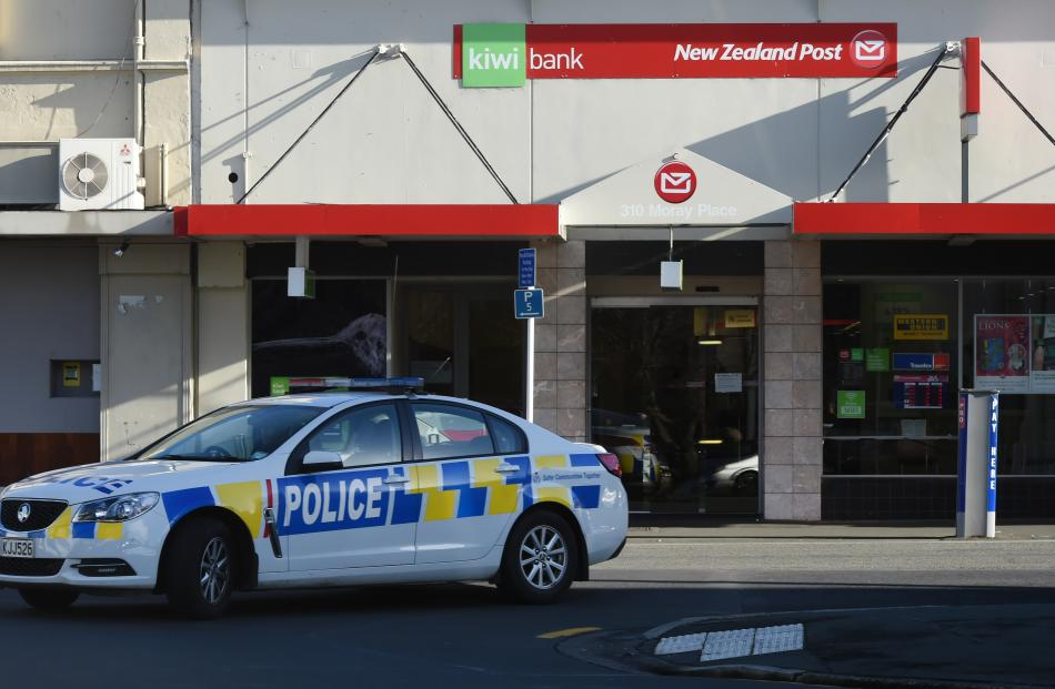 A patrol car is parked in front of the former adult entertainment venue where the package was discovered by a member of the public. Photo: Gregor Richardson