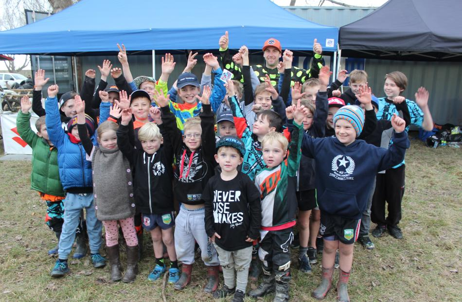 A group of motocross fans show their excitement at meeting international and professional motocross star Ben Townley at the Hasler Memorial Trophy Motocross race yesterday.