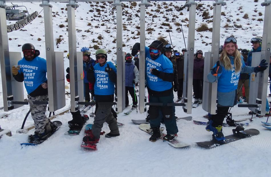 About 150 people were lined up ready and waiting for the chairlifts to be turned on at Coronet Peak for the first time this winter on Saturday morning.  Photo: Tracey Roxburgh