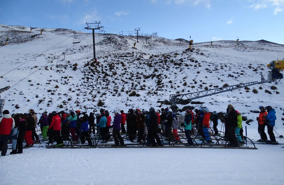 About 150 people were lined up ready and waiting for the chairlifts to be turned on at Coronet Peak for the first time this winter on Saturday morning.