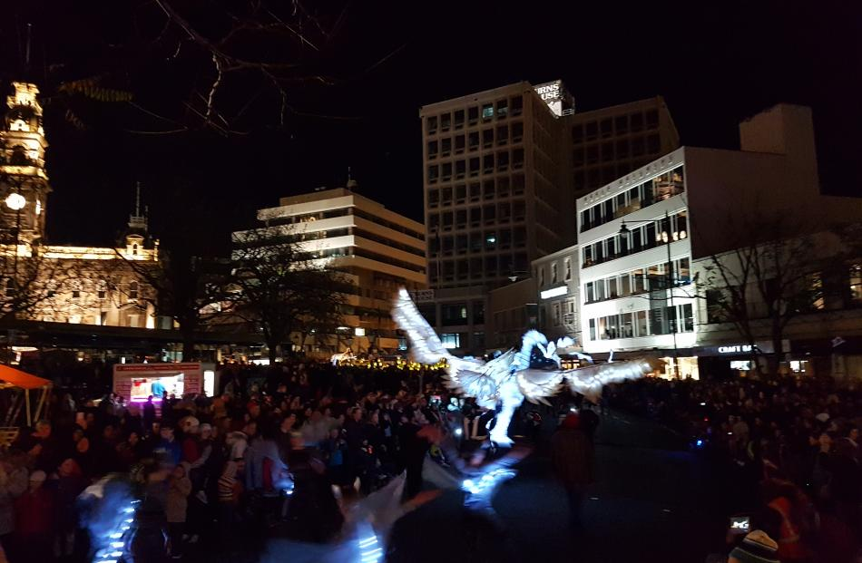 An eagle light puppet swoops through the crowd. Photo: Vaughan Elder
