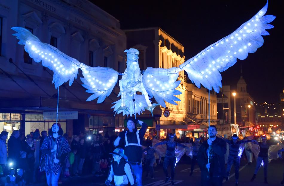 Performers control an eagle light puppet for the Nocturnal animals themed carnival. Photo: Gregor...