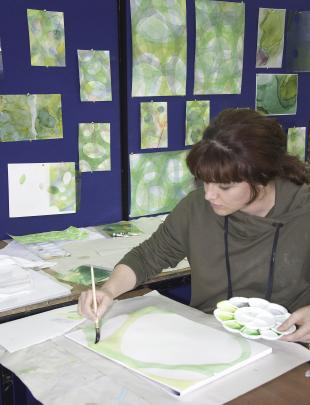 Chanel Taylor works on the watercolours she is creating as part of the Art and Genetics Exhibition. Photos: Supplied