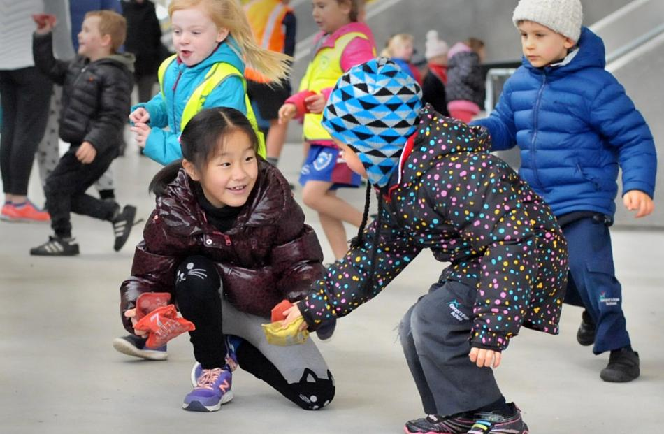 Shuo Yu,  of Arthur Street School, and Lydia Peters, of Grants Braes School. Behind them are St...