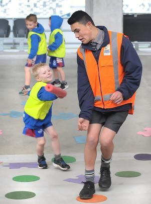 Luke O'Brien (5), of Mosgiel, tags Parker  Aluesi (14), of Otago Boys' High School.