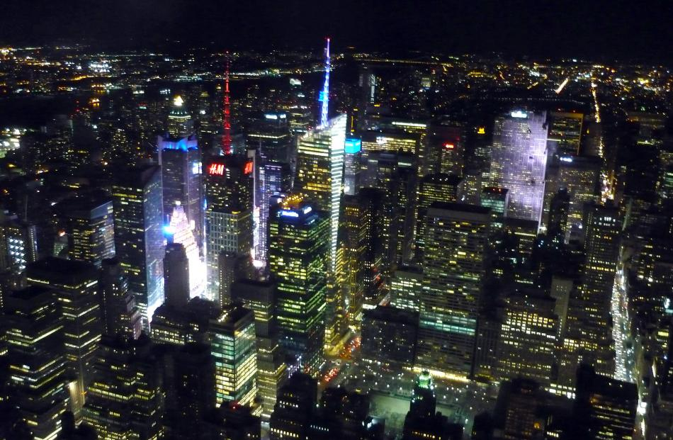 The bright lights of Times Square from the Empire State Building.