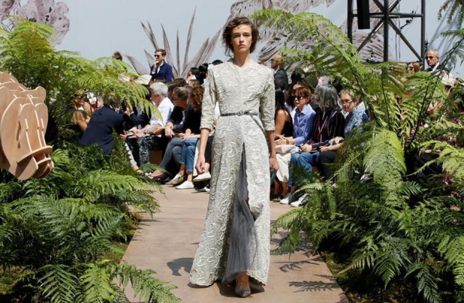 On a fern-lined catwalk dotted with wooden lions and giraffes, designer Maria Grazia Chiuri presented the brand's Autumn-Winter collection. Photo: Reuters