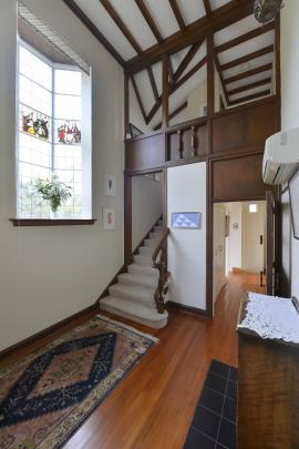 Wood and stained glass feature in the entry foyer.