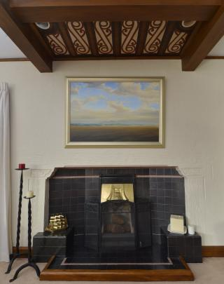 A ceiling panel with Maori motifs is a feature of the  lounge. The painting is Oreti Beach, by...