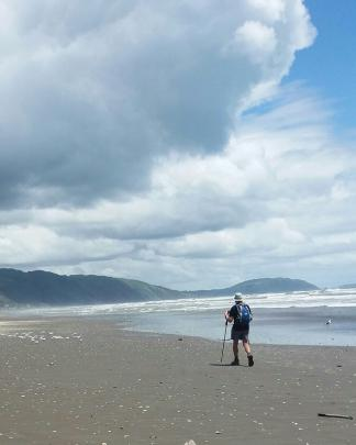 Warwick walks along Ninety Mile Beach.
