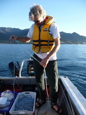 Dr Schallenberg on Lake Wanaka in 2012, lowering an instrument on a long rope to measure water...
