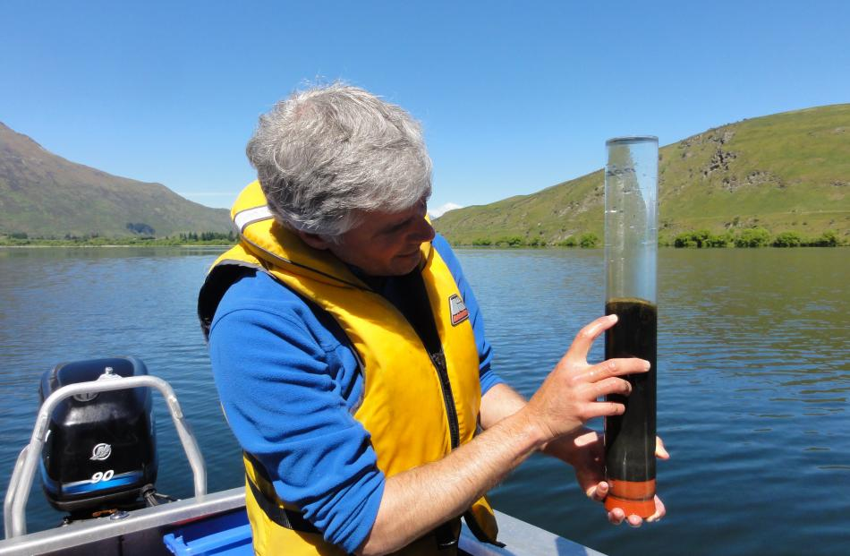 Dr Schallenberg with sediment core retrieved to study in-lake phosphorus recycling in 2014. ...