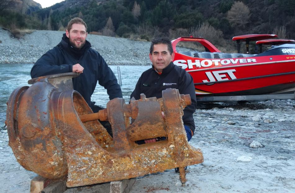 Jet-boat driver Joseph Coutts (left) pictured with Doc's Geoff Owen, found the old pump  while...