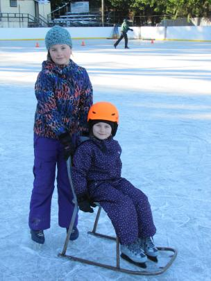 Sisters Amelia (10, left) and Zara (5) Dickey, of Cromwell, take a spin on the Naseby skating rink on Saturday.