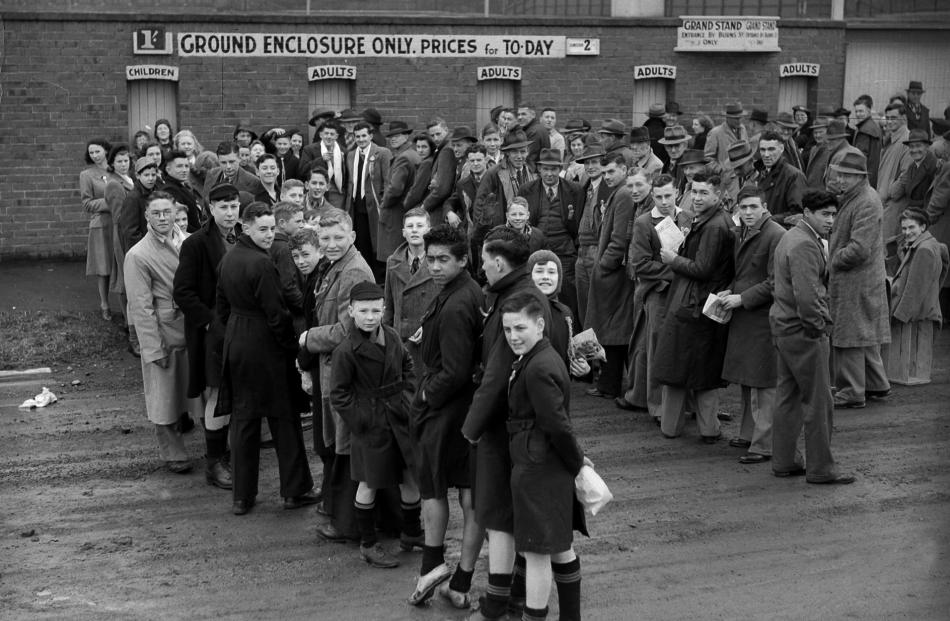 The Turnstile Building in its heyday, with fans waiting to get into the ground for Otago's first...