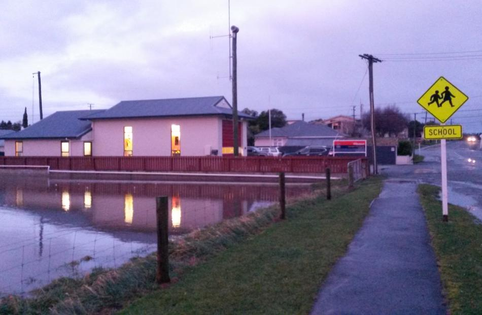 A flooded paddock turned into a paddling pool next to the Weston Volunteer Fire Brigade. Photo:...