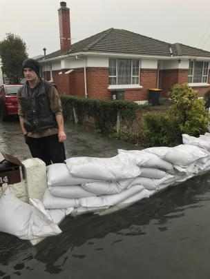 Shaun Bingard started sandbagging his house in  Gordon Rd, Mosgiel, on Saturday morning. Mr...