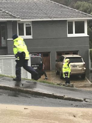 Police evacuate Bedford St residents in the Dunedin suburb of St Clair as a muddy deluge caused...