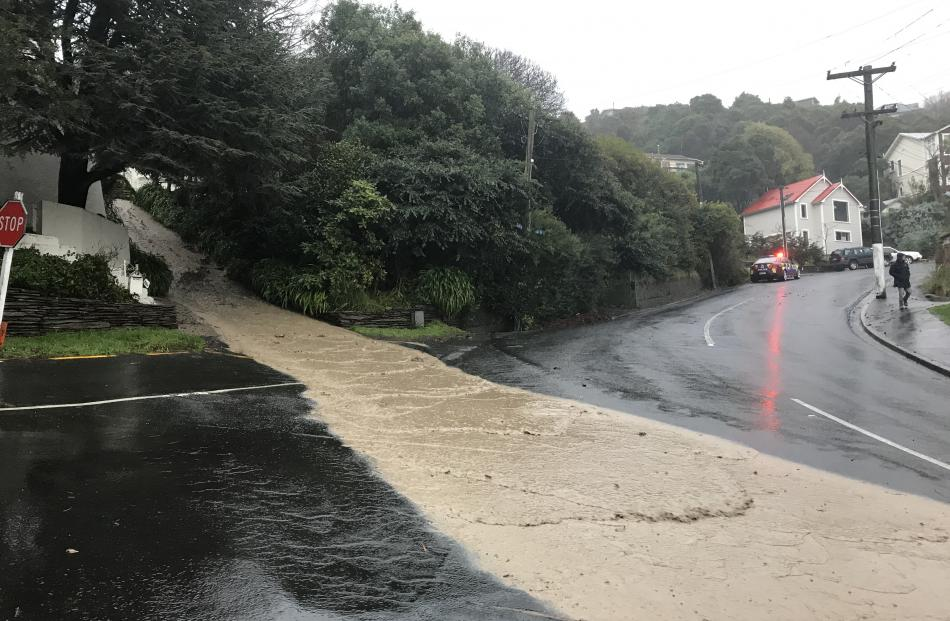 Residents at Ravenswood Rd and Bedford St were evacuated by police as a muddy deluge caused by a...