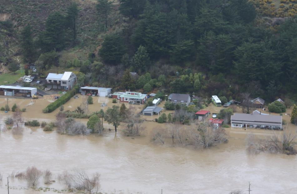 Flooding along a river in Taieri. Photo: ORC
