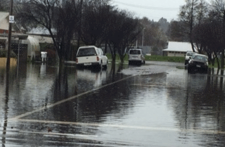 Surface flooding on Dryden street in Mosgiel. Photo: Craig Page