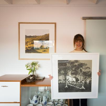 Emma-Kate Moore with one of her drawings, which will be exhibited at the New Zealand Academy of Fine Arts alongside the other shortlisted works.