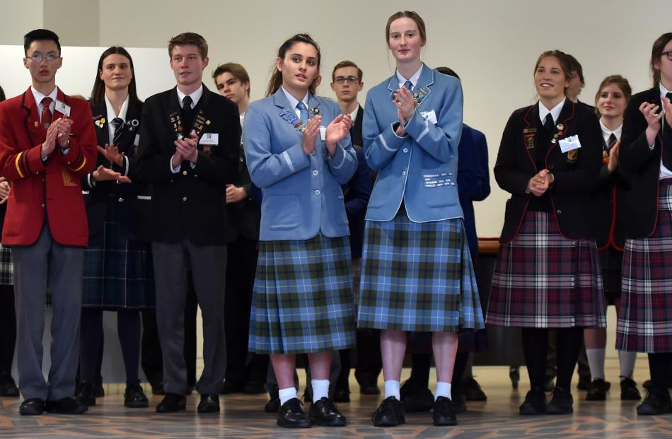 Pupils  look on during the ceremony.