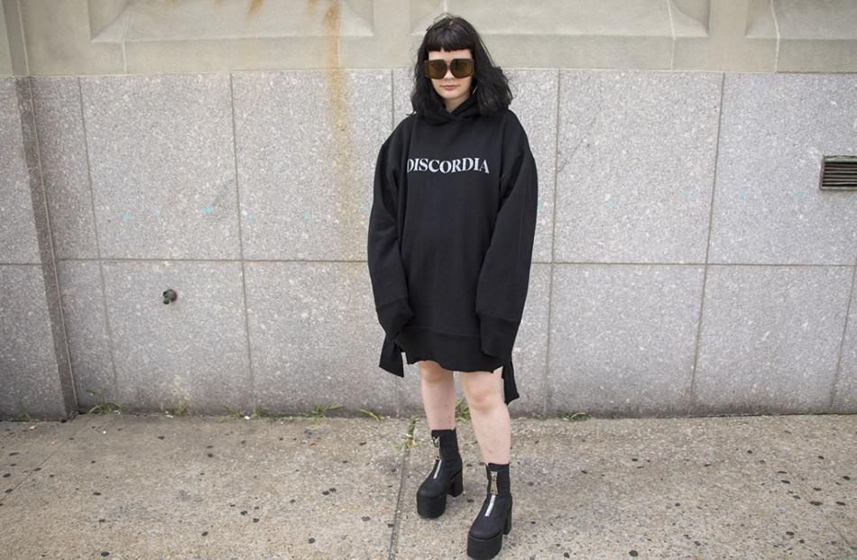 Julia wears JPalm 'Discordia Hoodie', Karen Walker Eyewear, Dolls Kill Boots.