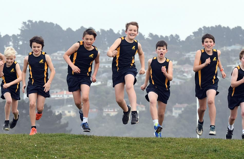 The Tainui boys team warms up prior to its race. Photos: Stephen Jaquiery