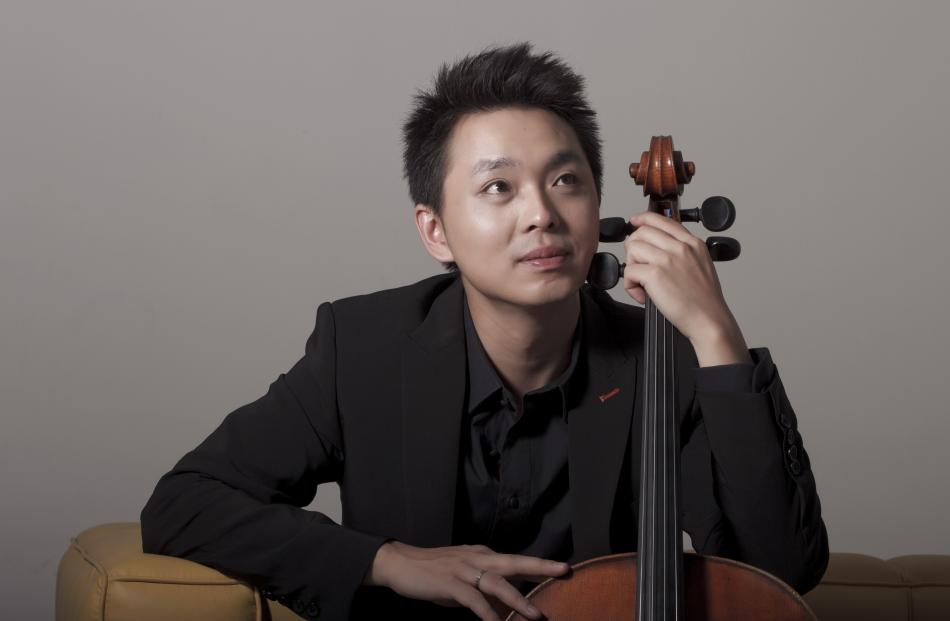 Li-Wei Qin is looking forward to playing his ''old friend'' the Dvorak cello concerto again. Photos: Dong Wang