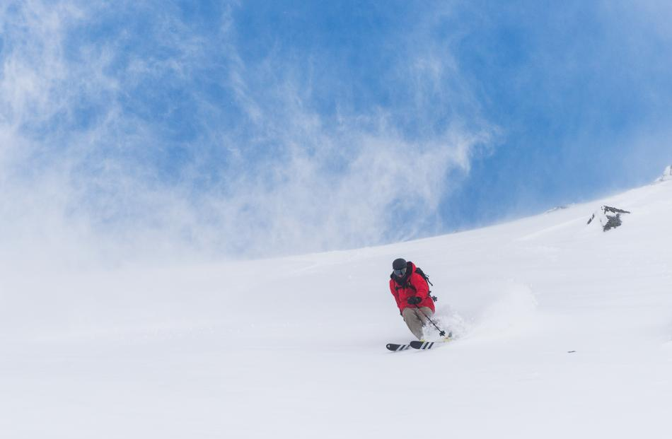 A skier enjoys the conditions at the Remarkables Queenstown before heavy a snowfall on Saturday...