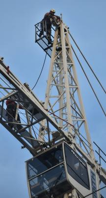 A worker on top of the crane on Saturday afternoon.