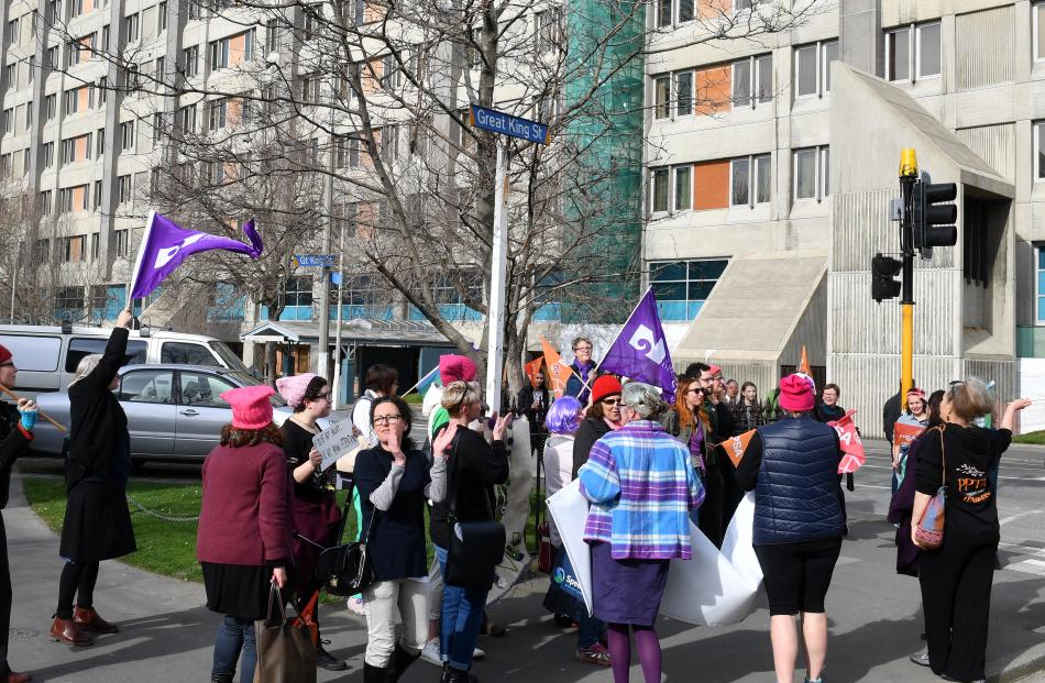 Protesters applaud themselves after chasing the Prime Minister out the rear entrance to the Dunedin public Hospital. Photo: Stephen Jaquiery
