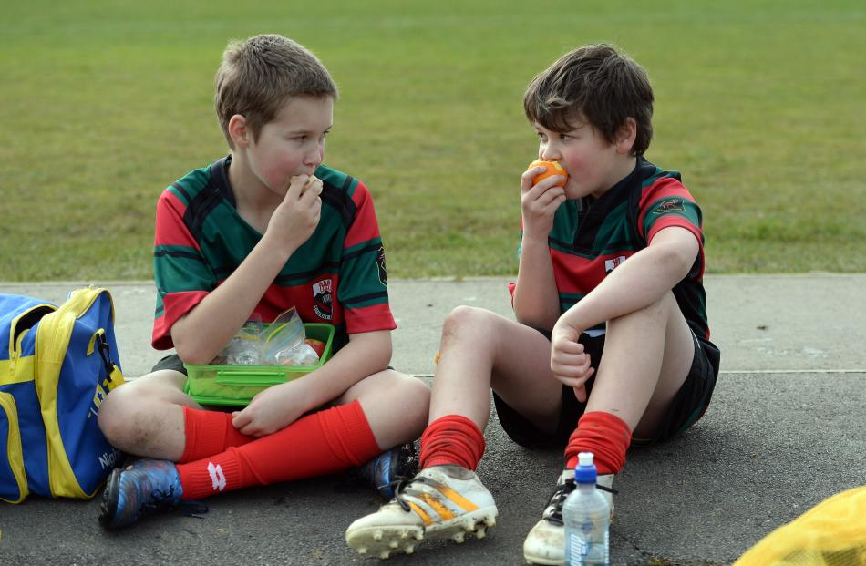 Kaikorai Valley College's Tyrone Bell (left, 12) and Vaughn Stewart (11) enjoy a snack during a break between games.