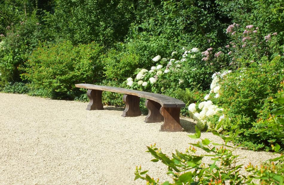 A seat is an asset to any garden, large or small. Photos: Gillian Vine