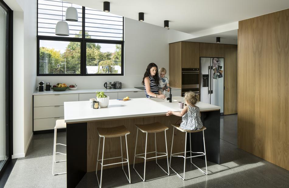 Part of the kitchen has a two-storey void with a slatted, north-facing window. The pantry is...