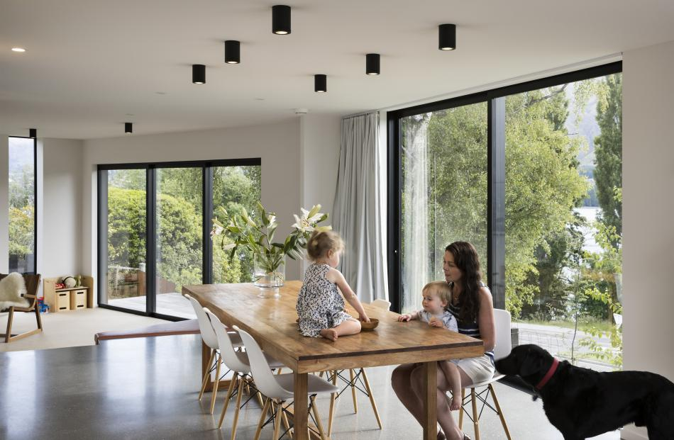 Interiors are light and simple, with level changes in floors and ceilings. The dining area...